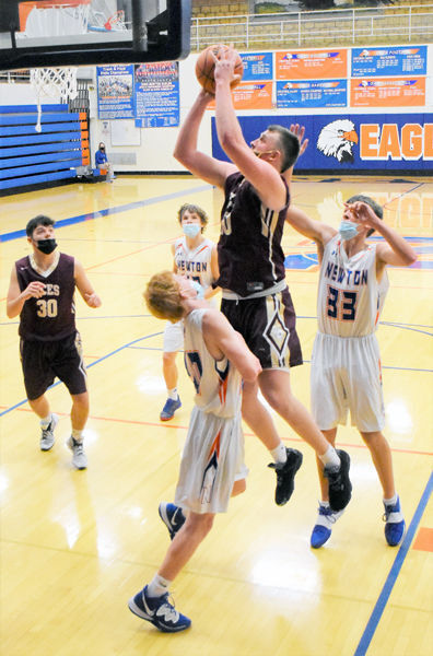 Golden Aces use inside, long shots for win over Newton