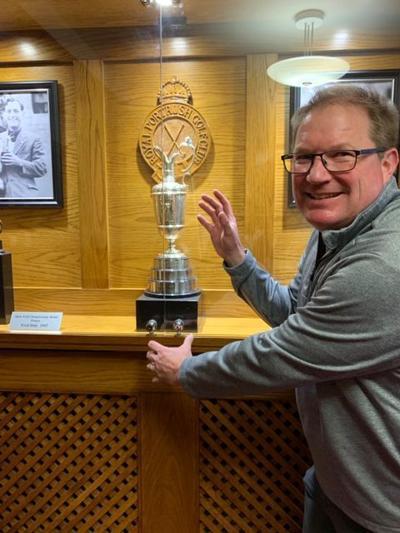 Sports Tom Golf Tom with a trophy.JPG