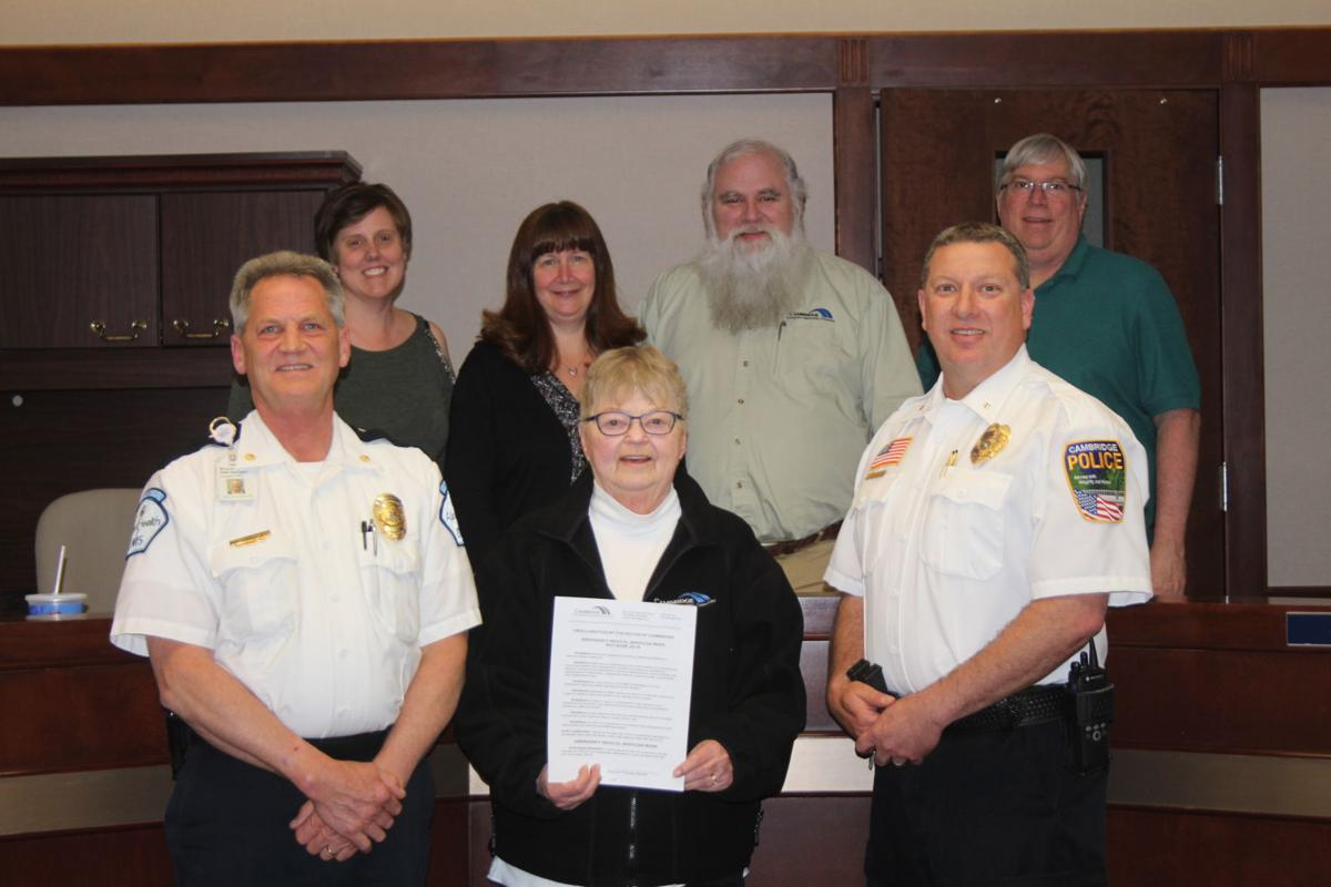 Cambridge Mayor Marlys Palmer proclaimed May 20-26 as Medical Services Week. Pictured in front are Allina Health Ambulance Operations manager Bruce Hildebrandt, Palmer and Cambridge Police Chief Todd Schuster. In back are Council Members Kersten Barfknecht Conley, Lisa Iverson, Joe Morin and Jim Godfrey. Hildebrandt mentioned in 2017 there were 1,100 calls for service in the city of Cambridge and the number continues to increase each year. Photo by Rachel Kytonen