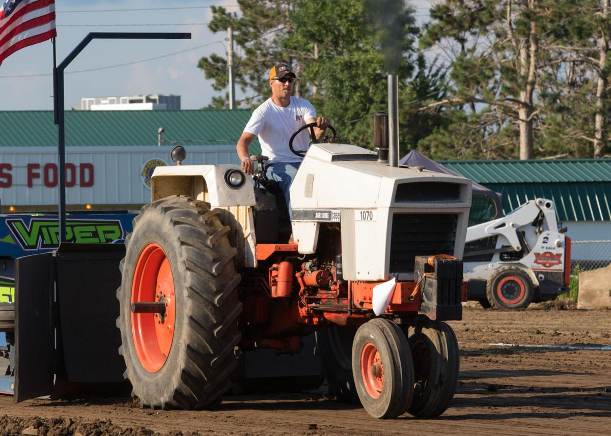 Sports Notebook: Truck and tractor pulls tug in fair's