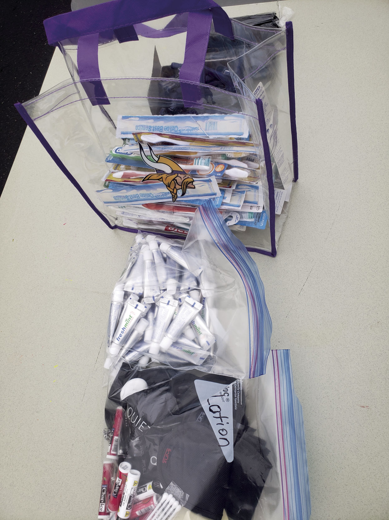 Maple Grove resident packs care kits for the homeless in his driveway