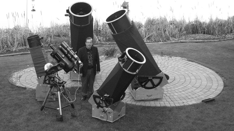 Mike Lynch with telescopes.jpg