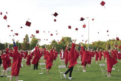 Westonka graduation 2020 - caps in the air.JPG