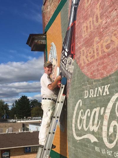 Historic NB Coca-Cola mural gets a face lift