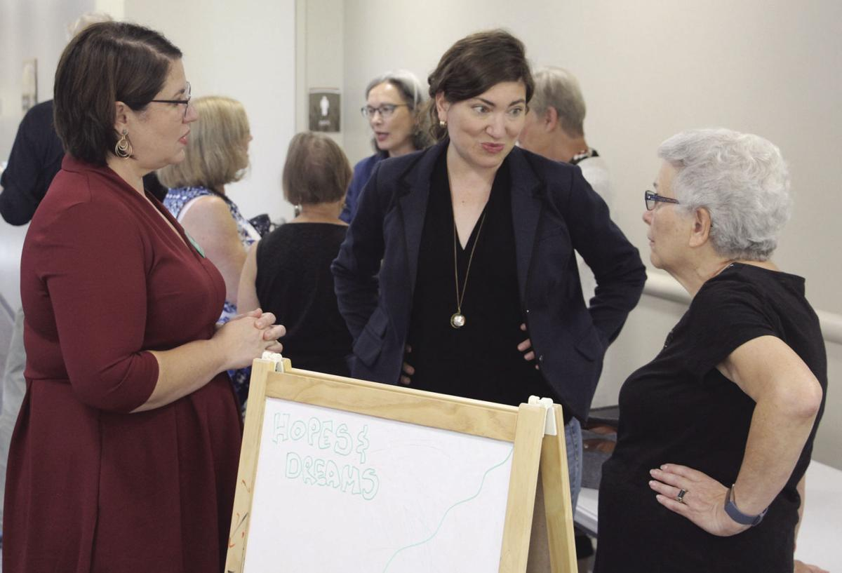 Councilmember Rebecca Schack meets with forum attendees