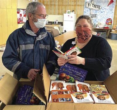 Maple Grove Rotary reaching out with books