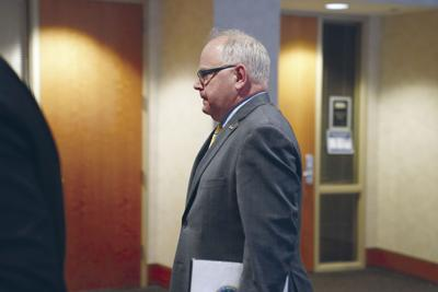 Walz self-quarantines; wrestles with shelter-in-place order