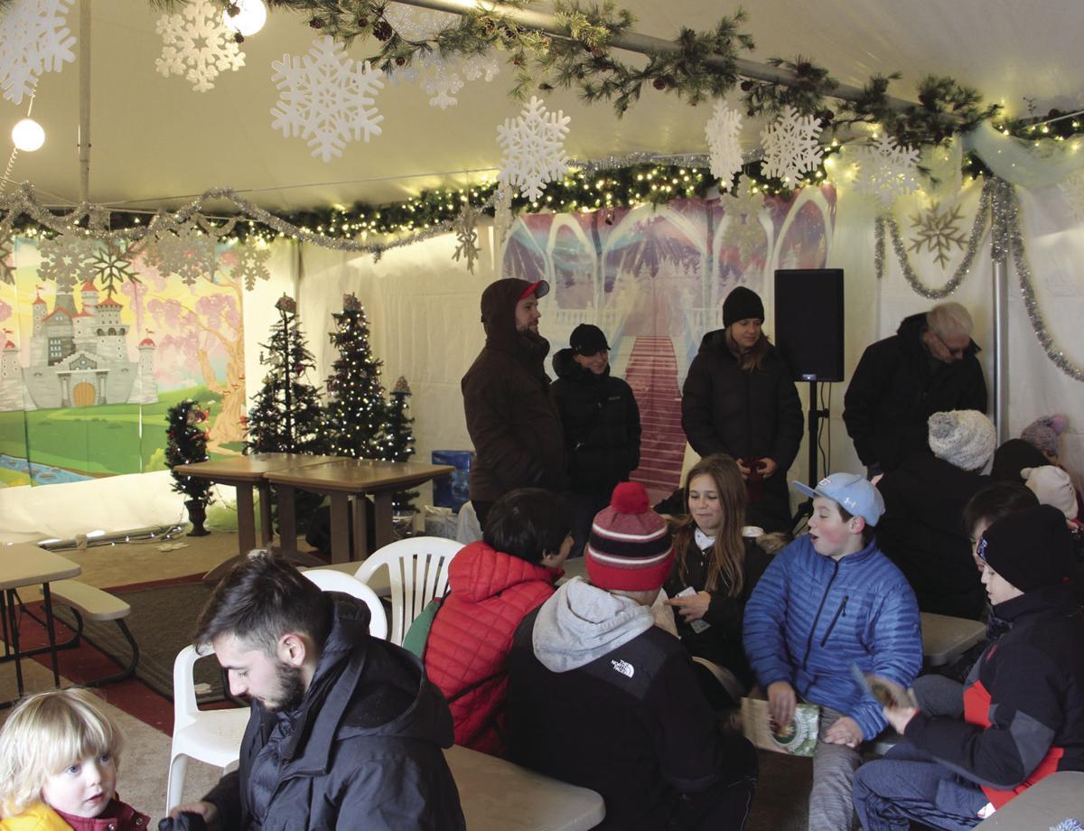 Christkindlsmarkt attendees warm up