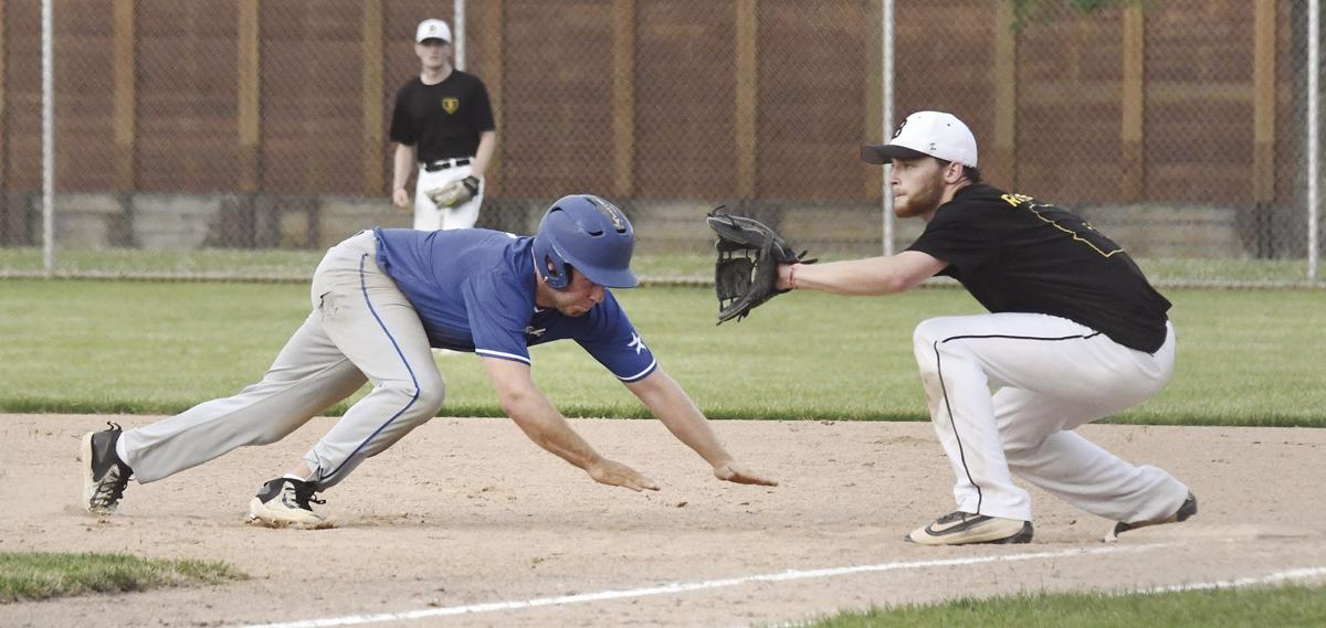 Knoll dives back to first base