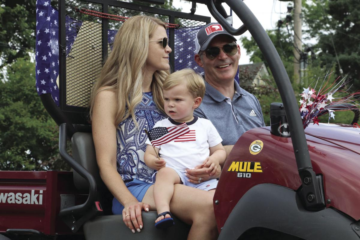 LE Fourth Parade flag toddler with parents.jpg