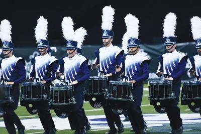 Drum and bugle corps march into Farmington 1