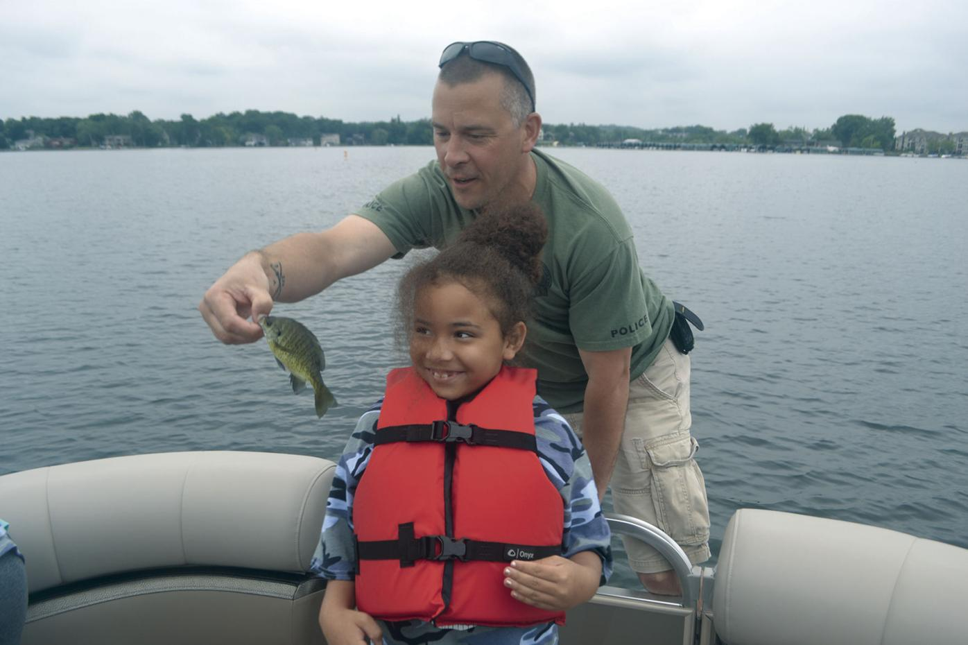 Hopkins police officers, local children hit Lake Minnetonka for a day of boating, fishing