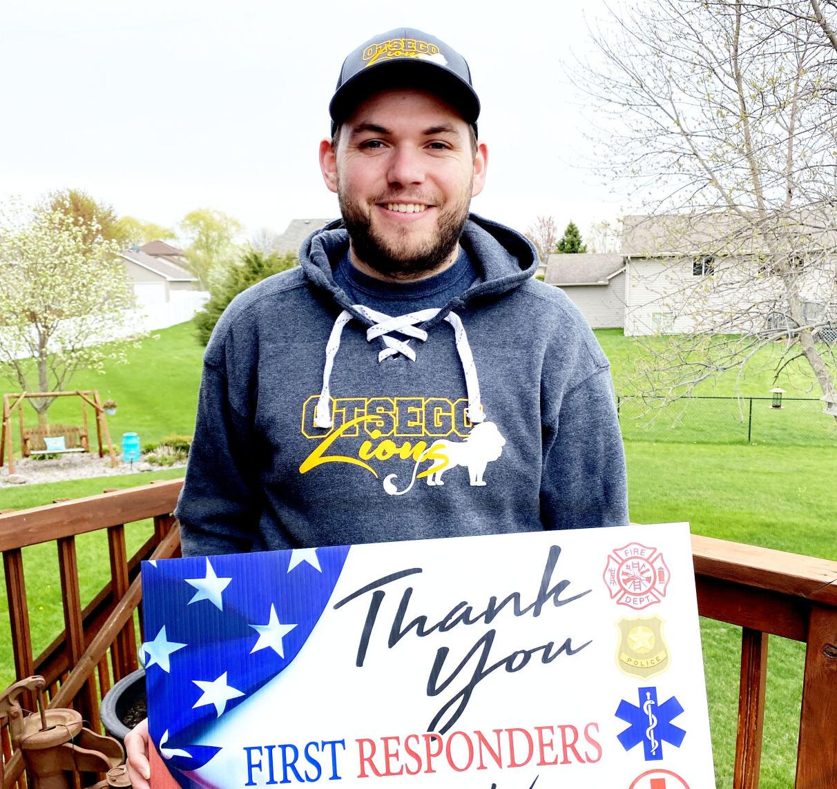 otsego pres stockamp with first responders sign.jpg