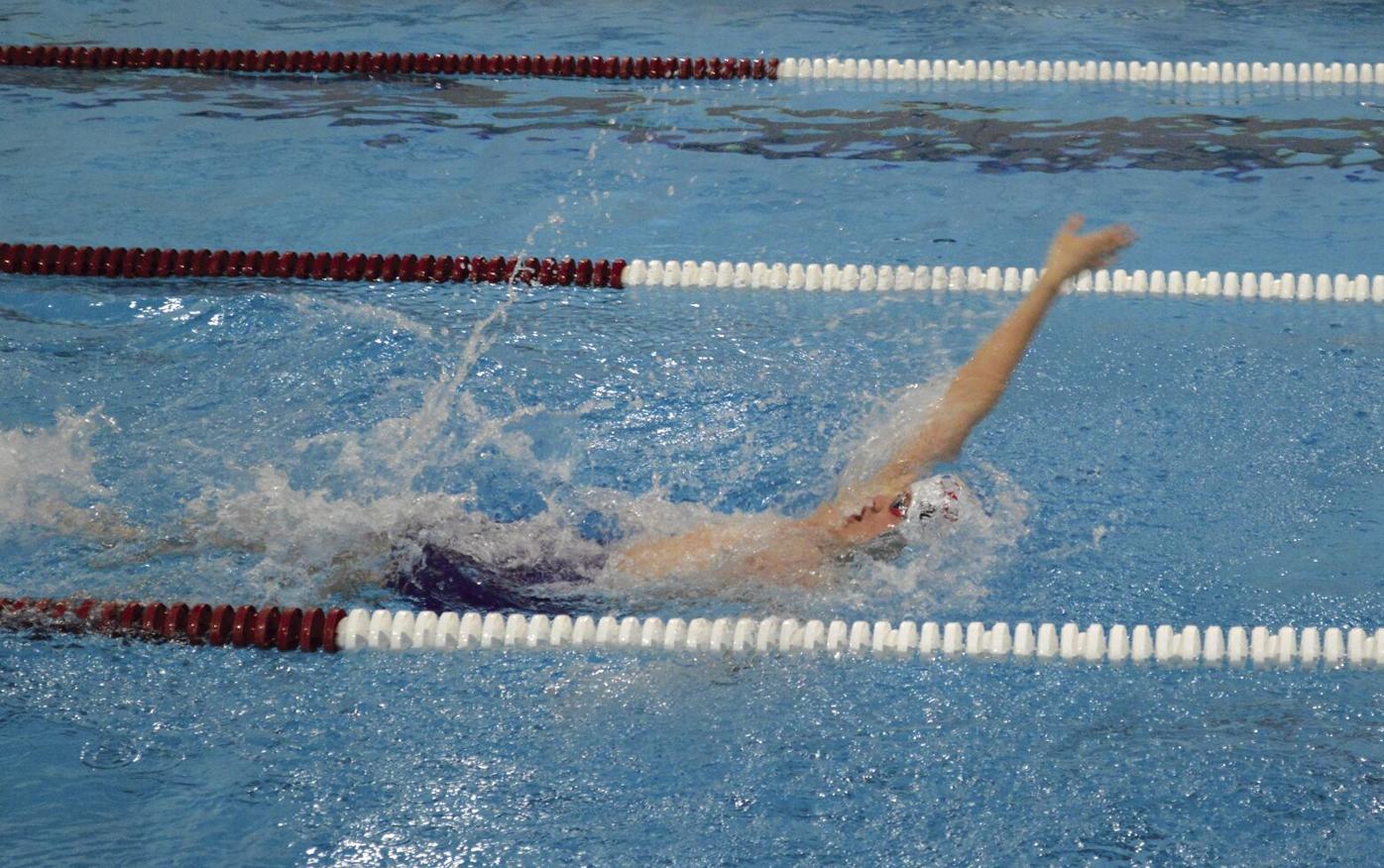 Crimson Boys Swim and Dive breaking team records