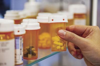 pill bottles on shelf.jpg