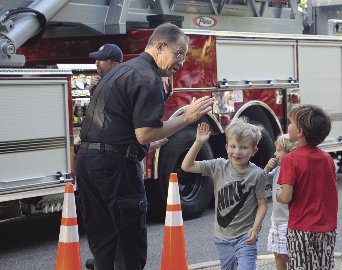 Minnetonka Firefighter high-fives