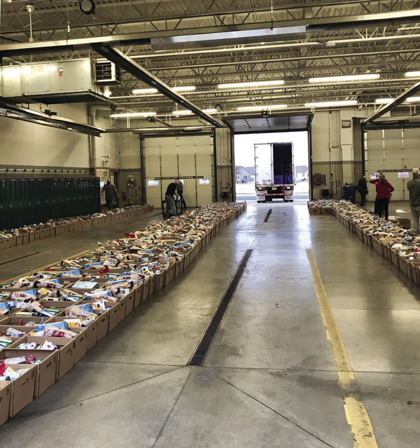 40 Years strong: Maple Grove Lions and fire fighters team up for food baskets for needy families
