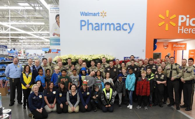 the anoka county sheriffs office shopped with andover students at walmart on dec 13 for its own shop with a cop event