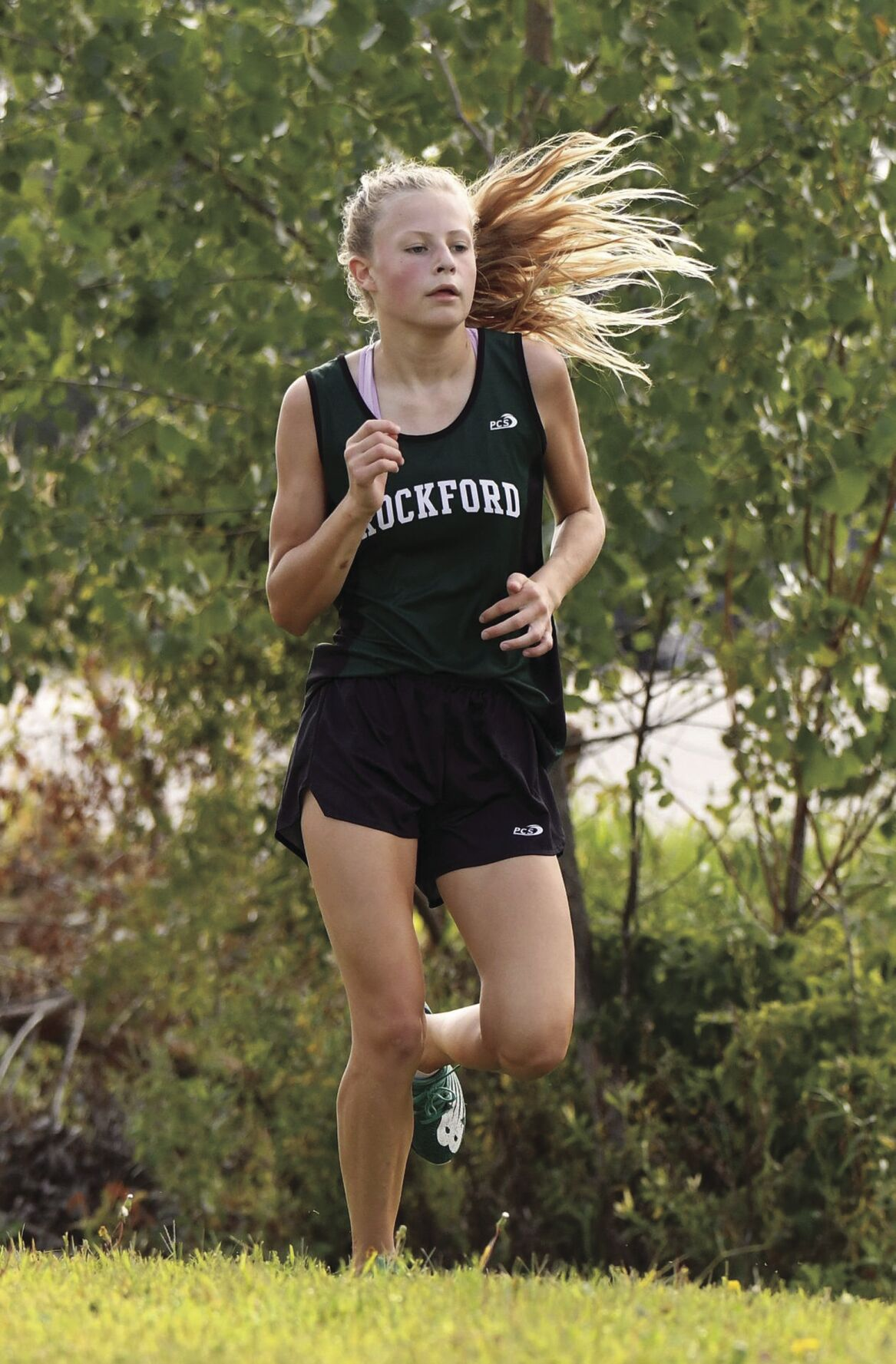 Rockford girls cross country runners moving up fast