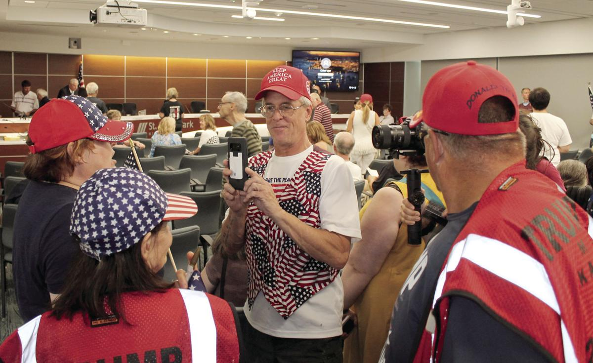Demonstrators express loud support for the Pledge of Allegiance at St. Louis Park council meeting - 1