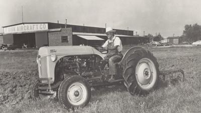 Funk Ford featured on vintage tractor calendar   Long Lake