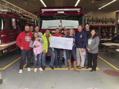 Fire department brew donation.jpg