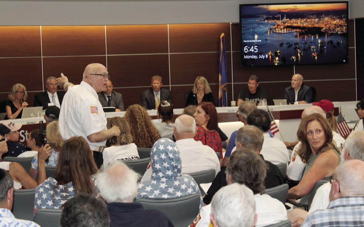 Demonstrators express loud support for the Pledge of Allegiance at St. Louis Park council meeting - 2