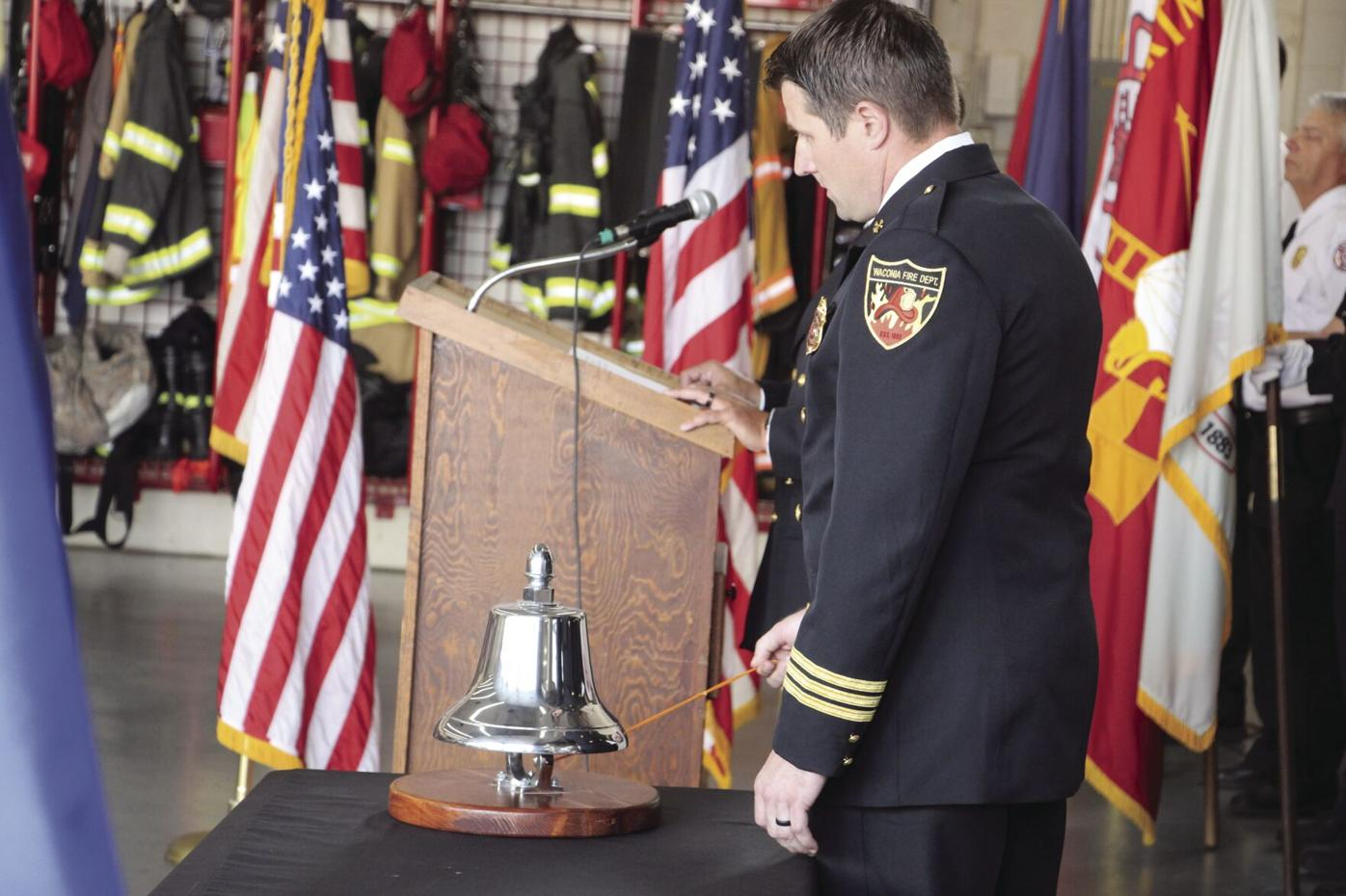 911 Assistant chief Justin Sorensen rings bell.JPG