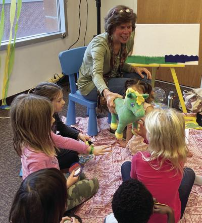 """""""Grammy Lisa"""" introduces Mr. Green Pony to the kids."""