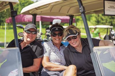 Women in golf cart.jpg