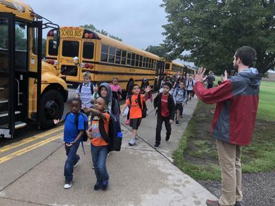 AH School Bus students arrive generic