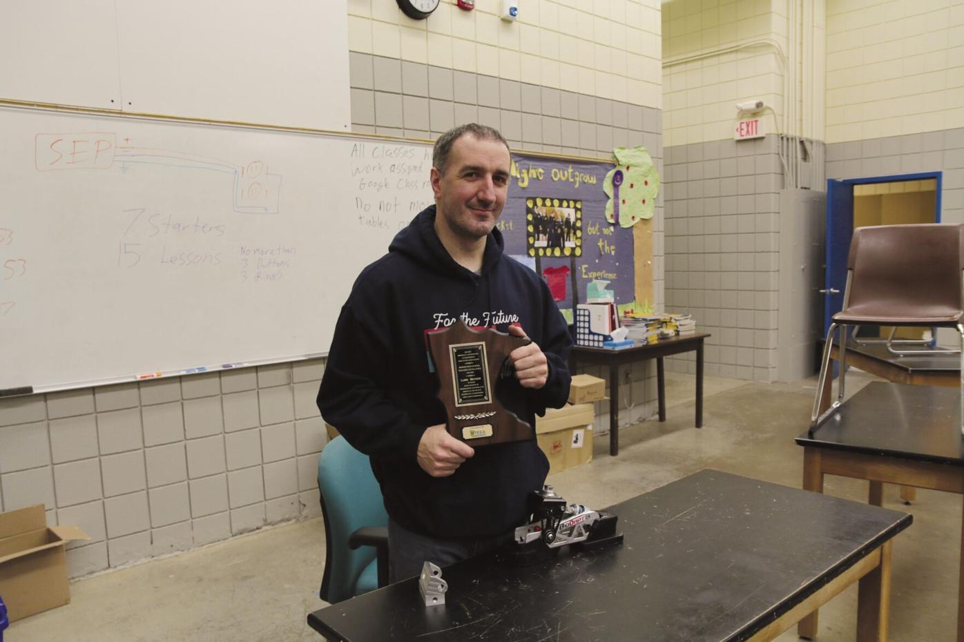 Becker holding award.jpg
