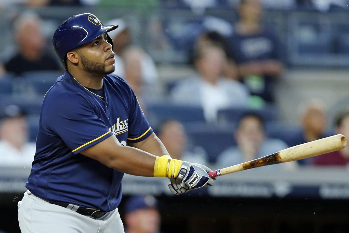 Jesus Aguilar hitting, AP photo