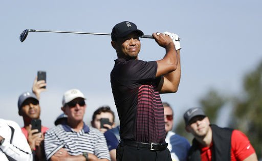 Tiger Woods tee shot, AP photo