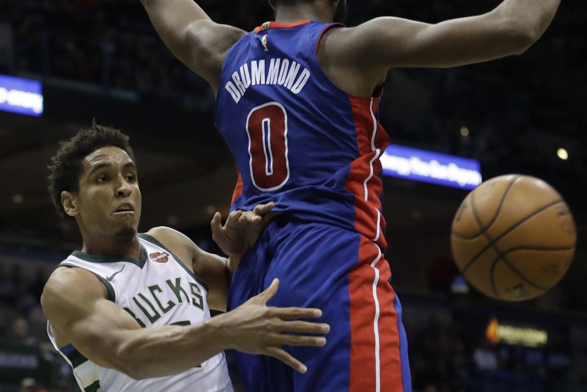 Malcolm Brogdon passes, AP photo