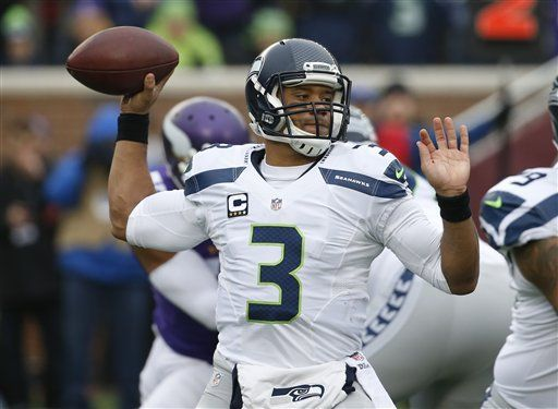 Russell Wilson passing, AP photo