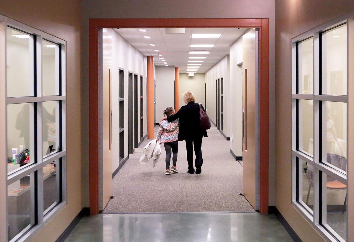 Donna and Natalie walking down hallway