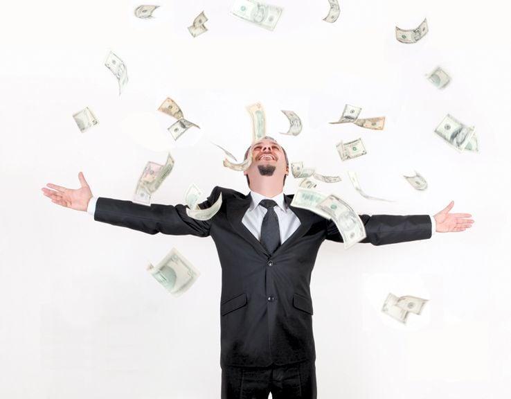 iStock money rains on buisinessman