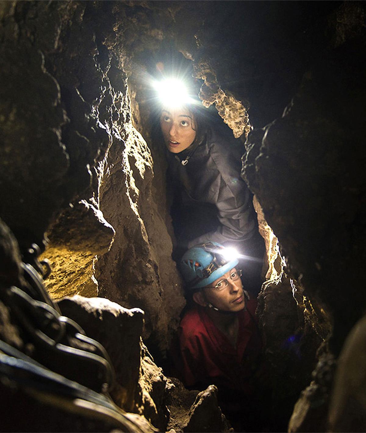 Excavators in cave