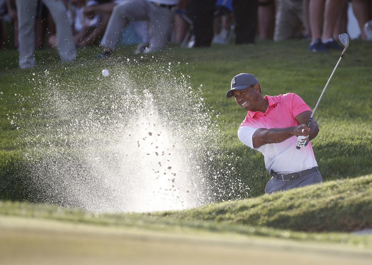 Tiger Woods hits out of sand, AP photo