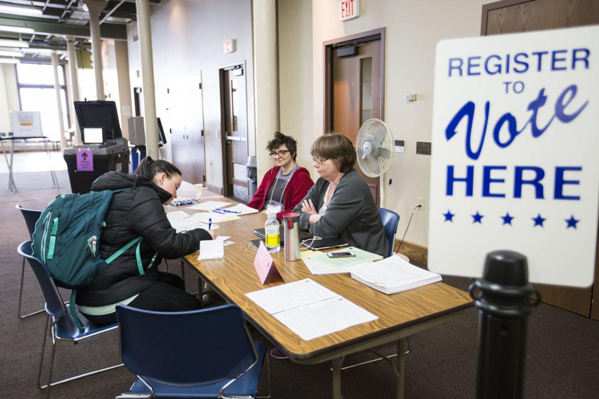 Student registers to vote on Election Day