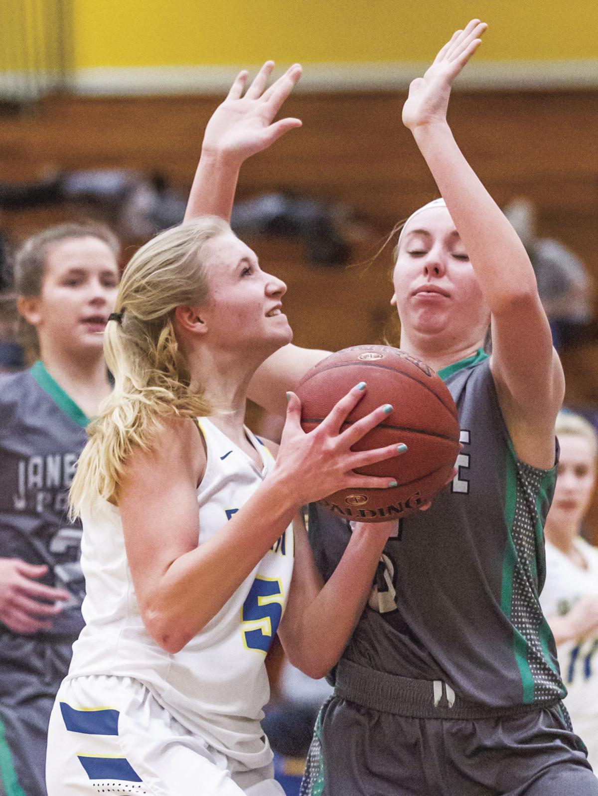 Prep girls basketball: Madison West's Kaitlin Manke drives past Janesville Parker's Julia Hartwig