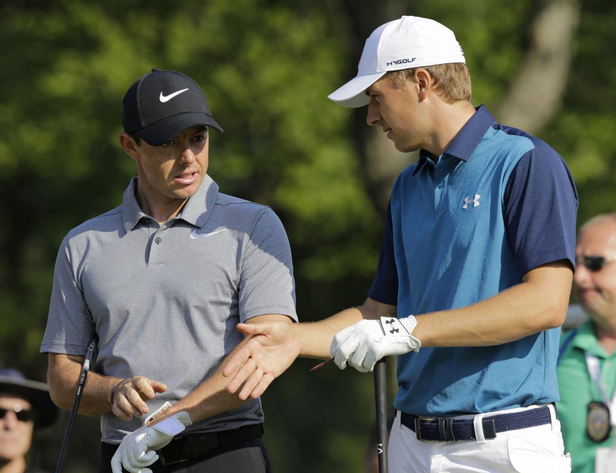Jordan Spieth, Rory McIlroy, on tee, AP photo