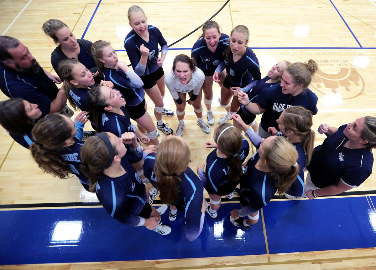 Prep girls volleyball photo: Lakeside Lutheran girls huddle up during a match