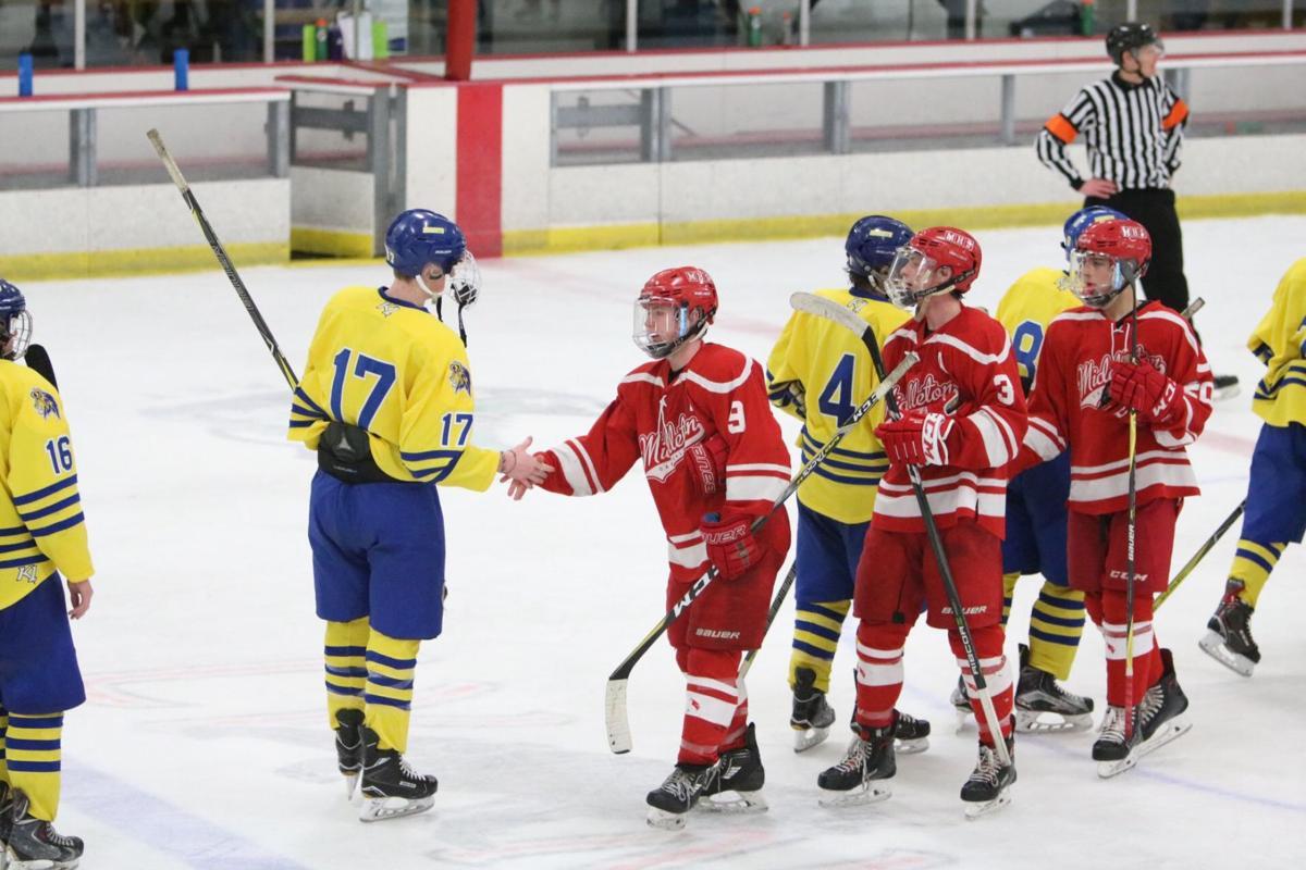 Middleton, Madison West boys hockey teams shake hands after Middleton's overtime victory