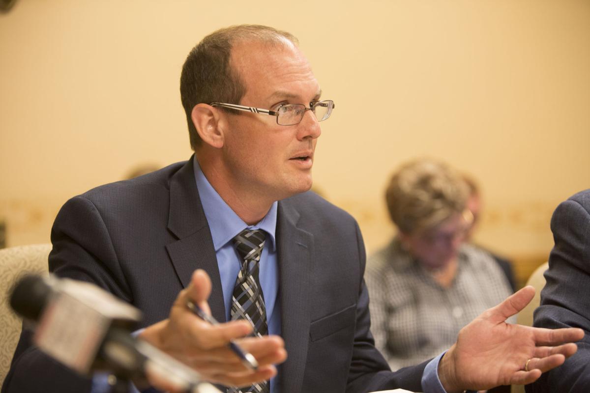 Conservative lawmaker announces he won't seek re-election