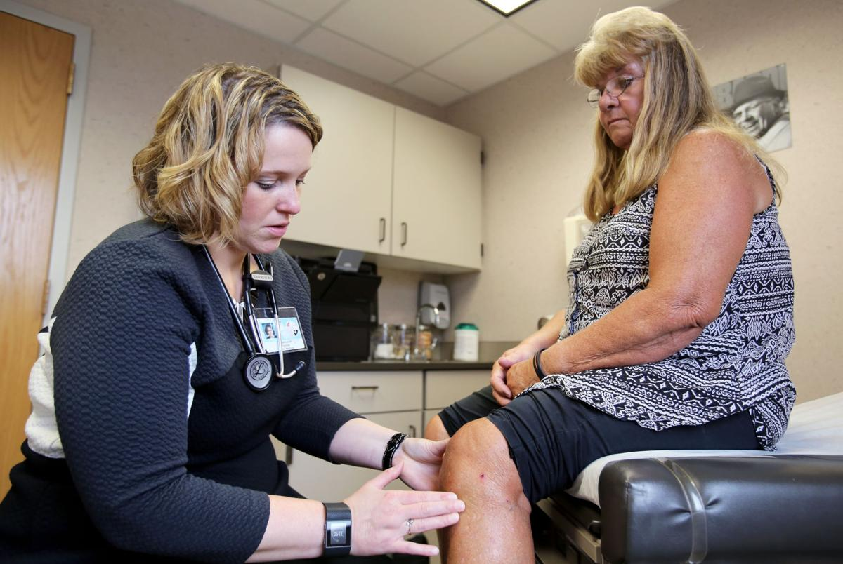 Dr. Sebranek checking Sandy Welte's knee