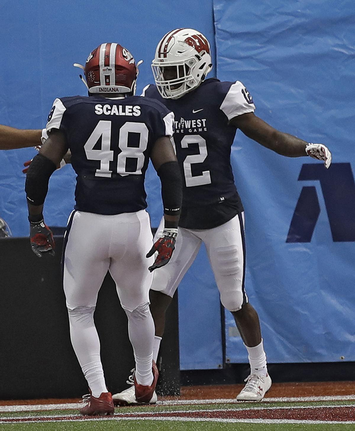 Natrell Jamerson celebrates TD with Tegray Scales, AP photo