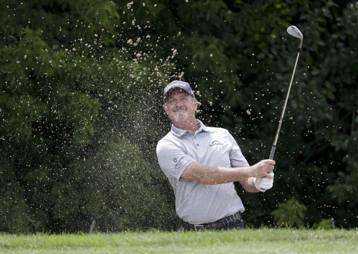 Jerry Kelly hitting out of a bunker, State Journal photo