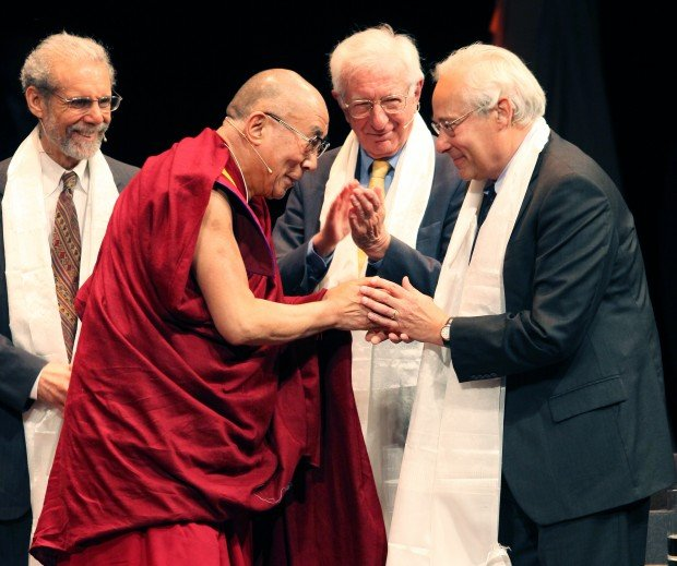 Dalai Lama thanks panel participants with scarves